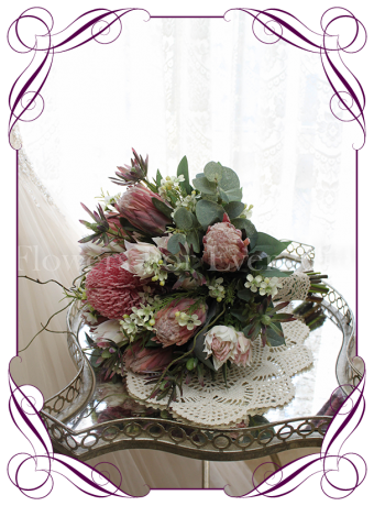 image of beautiful artificial native silk bridal flowers with pink protea and native leaves