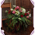 This falling artificial bridal posy shape features silk protea, peonies, red large bud roses, deep vintage pink Alice roses, red bud rose, white magnolia, white berries, draping green berries, salvia, flowering birch, ferns grasses and vine. Silk bridal bouquet, whimsical wedding flowers, forest wedding,