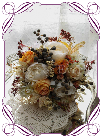 Rustic silk artificial wedding flowers in Autumn Fall bridal bouquet colours. With burnt yellow roses, ivory cream peonies, peny buds, blushing bride protea, dark brown berries, rustic berries and champagne ferns.