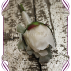 An elegant silk mens boutonniere with classic artificial blooms in a simple style. With a peony bud on dusty miller foliage, this button design can complement a large range of wedding colour schemes.