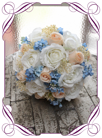 An elegant silk bridal bouquet with classic artificial blooms in sweet rustic wedding colours. With soft blue and apricot silk flowers, this bouquet design can complement a large range of wedding colour schemes.