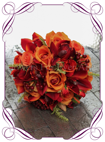 a bright silk artificial bridal bouquet of vibrant burnt orange orchids, orange roses and berries. Classic yet unique in design