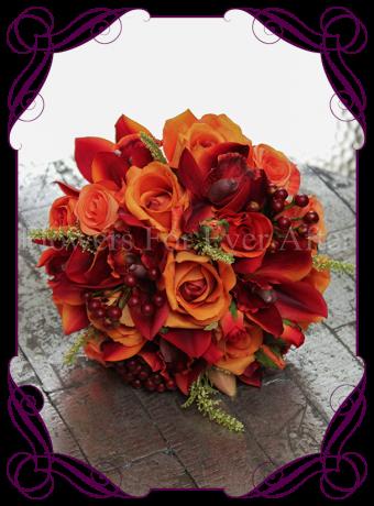 a bright silk artificial bridal bouquet of vibrant burnt orange orchids, orange roses and berries. Classic yet unique in design