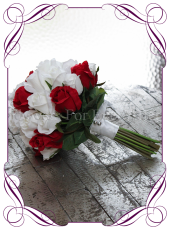 classic elegant silk artificial bridesmaids bouquet or small bridal bouquet. Features red and white roses in a deep posy.
