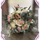 Rustic light pink and champagne silk wedding bouquet. With artificial tulips, roses and foliage.