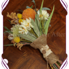 Desert australian native silk wedding bouquet made in melbourne featuring kangaroo paw, eucalyptus leaves, banksia, protea and bottle brush. A beautiful rustic bridal bouquet. Autumn Fall look.