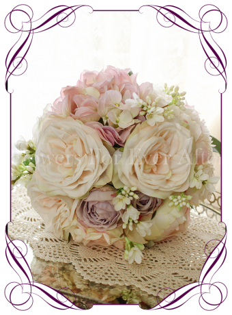 This beautiful blush silk bridal bouquet features a combination of roses and peonies in various blush tones perfect and versatile.