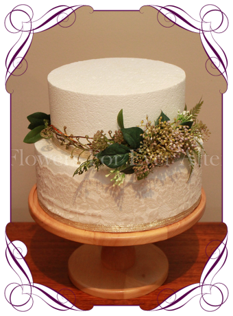 rustic cake flowers made with artificial foliage and berries.