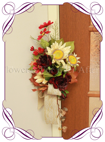 Fall / Autumn theme silk wedding arbor / arbour decoration. A thick garland or artificial blooms and berries in deep Autumn / fall tones.