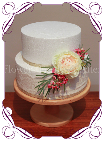 A vibrant tropical wedding cake flowers decoration. This silk cake topper features an apricot peony with coral blooms, berries and fern.