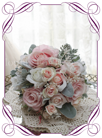 Pink and white rose bouquet in an elegant wedding style with a unique twist. Silk artificial bridal bouquet