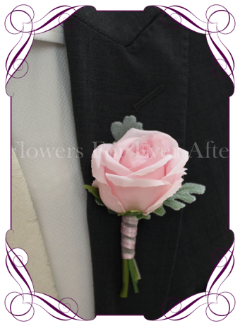 Silk grooms, groomsmans flower. Pink artificial rose on fake foliage. Elegant gents button boutonniere