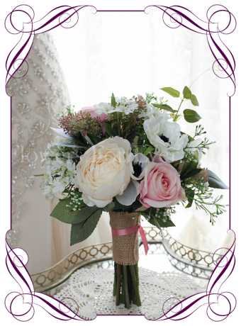 Pink and white rustic silk artificial wedding bouquet design. A unique bridal bouquet with a mix of fake peonies, roses, anemone and berries.