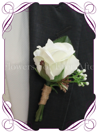 Silk grooms, groomsmans flower. White artificial rose on fake foliage. Elegant gents button boutonniere