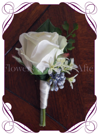 Silk grooms, groomsmans flower. White artificial rosewith blue berries and jasmin on fake foliage. Elegant gents button boutonniere