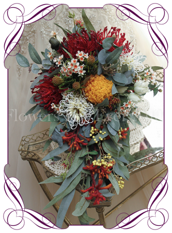 Australian native silk artificial wedding bouquet in traditional desert colours with red, orange and yellow with gum leaves. Cascading tear bridal bouquet. Made in Melbourne.