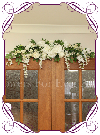 White wedding arch/arbor/arbour decoration in silk/artificial roses, wisteria, baby's breath & foliage. Elegant decoration with hanging flowers for a classic or rustic, Boho event... Unique & Made in Melbourne! Silk Wedding Flower Design Specialists!