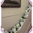 Ivory white rose and lilac lavender orchid garland, arbour / arbor arch decoration. Made in Melbourne. Custom order. World wide shipping.