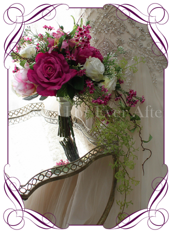 A romantic vibrant magenta pink and blush ivory cascading / showering posy silk artificial wedding bouquet. Perfect for a garden, rustic or boho style wedding.