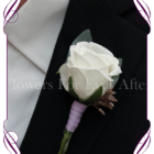 Gents / mens wedding flower button / boutonniere in ivory white and lilac purple with gum foliage.