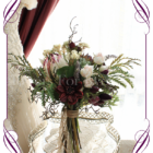 Rustic boho whimsical silk flower bridal bouquet, in warm dark tones. With Australian natives and burgundy unusual flowers. protea, dahlia, gum nuts, lavender, twig branches. Made in Melbourne, ships world wide.