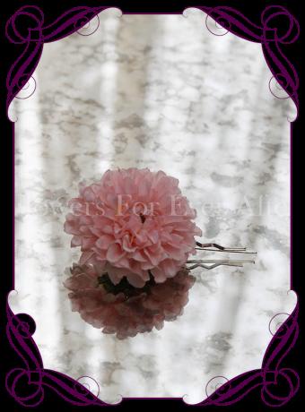 pink silk artificial hair flower on pin.