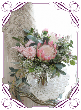 Elegant rustic wedding bridal bouquet / posy with artificial silk pink protea, peony and Australian native foliage and baby's breath. Made in Melbourne. Shipping worldwide.