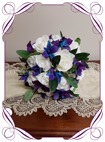 white roses and galaxy blue orchids with native gum foliage. A romantic silk artificial bridal bouquet style with a touch of colour. Made in Melbourne. Shipping worldwide